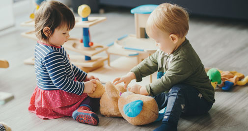 two young toddlers playing together